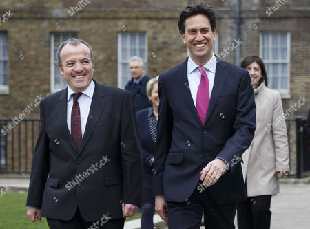 Mike Kane, newly elected Labour MP for Wythenshawe and Sale East arrives at the House of Commons with Ed Miliband following his by-election victory