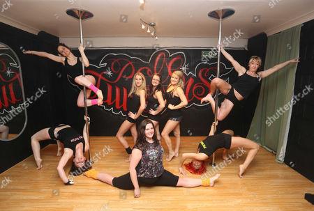 Stock Picture of Clockwise from bottom left: Pole dancers Kimberley Jones, Reb Wilkshire, Laura Fidoe, Sian O'Shea, Tina Lediard, organiser Lisa Broughton and Emily Kennedy