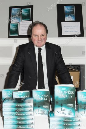 James Naughtie with copies of 'The Madness of July'