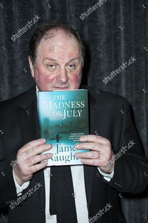 James Naughtie with copy of 'The Madness of July'