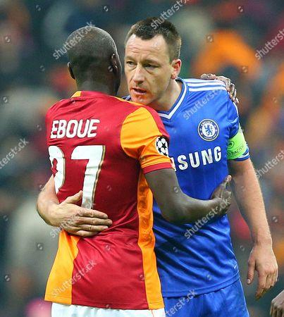 John Terry of Chelsea hugs former Arsenal defender Emmanuel Eboue of Galatasaray at full time