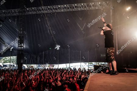 American heavy metal (metalcore) singer Jamey Jasta cheers up the listeners at metal fans at the Arena stage during the concert with Hatebreed at Roskilde Festival 2013. Denmark.