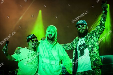 The German rapper Marsimoto is here pictured together with the two guest rappers Vokalmatador (L) and MC Fitti (R) at his live concert at the German hip-hop festival Splash Festival. Germany 2013.
