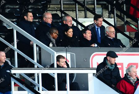 Lord Sebastian Coe looks on, back row right, behind Chelsea Chairman Bruce Buck and Chief Executive Ron Gourlay