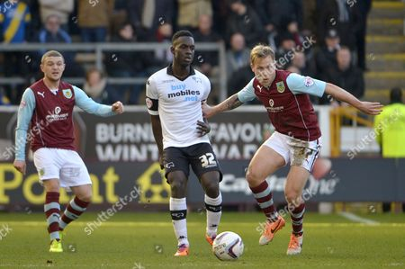 Simon Dawkins of Derby County competes with Scott Arfield of Burnley