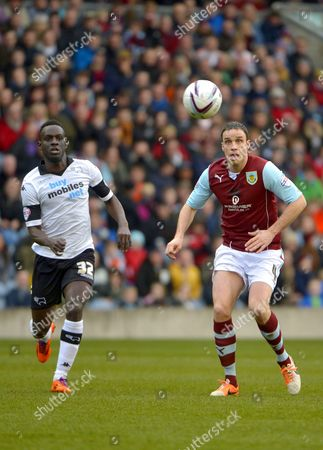 Simon Dawkins of Derby County and Michael Duff of Burnley watch the ball
