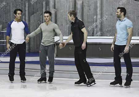 Stock Picture of Ray Quinn rehearses his showcase choreography with skate partner, and pro skaters, Sylvain Longchambon, Robin Johnstone & Andy Buchanan on his team.