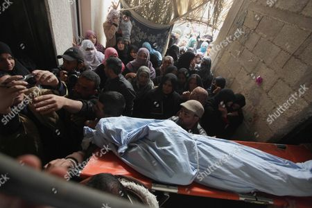 Stock Picture of Palestinians carry the body of Amena Atiyyeh Qudeih