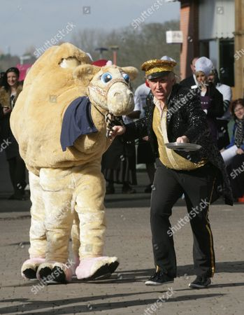 Kevin Cruise & his camel take time out from their Theatre Show The Kevin Cruise Comedy Cabaret to enter the pancake race