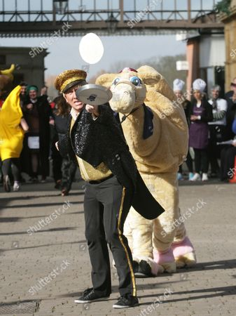 Editorial photo of The 2014 Windsor & Eton Flippin' Pancake Race at The Old Station, Windsor, Britain - 04 Mar 2014