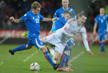 Gareth Bale, Ari Freyr Skulason and Aron Einar Gunnarsson