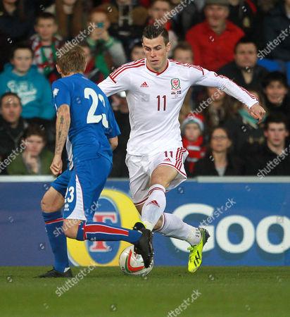 Gareth Bale of Wales gets past Ari Freyr Skulason of Iceland