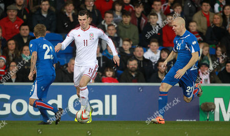 Gareth Bale of Wales gets past Ari Freyr Skulason of Iceland