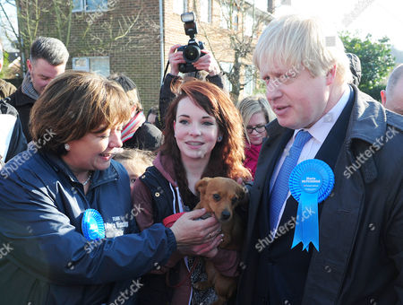 Media Attention Surrounds Maria Hutchings (left) Ellen Birnie 15 From Eastliegh With Her Dog Aby (middle) And Boris Johnson (right) Boris Johnson Joins Maria Hutchings The Conservative Candidate In A Cul-de-sac In Eastleigh To Hand Out Leaflets Encouraging People To Vote For Maria In The Eastleigh By-election To Replace Chris Huhnes Seat.chandlers Ford  UK  20/02/2013 Hampshire 2013.