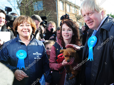 Media Attention Surrounds Maria Hutchings (left) Ellen Birnie 15 From Eastliegh With Her Dog Aby (middle) And Boris Johnson (right) Boris Johnson Joins Maria Hutchings The Conservative Candidate In A Cul-de-sac In Eastleigh To Hand Out Leaflets Encouraging People To Vote For Maria In The Eastleigh By-election To Replace Chris Huhnes Seat. Chandlers Ford  UK  20/02/2013 Hampshire 2013.