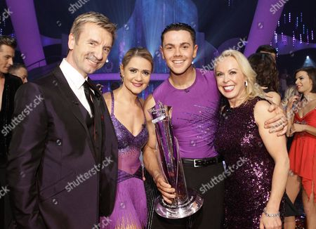 Ray Quinn and Maria Filippov are crowned as champions, accompanied by Jayne Torvill and Christopher Dean