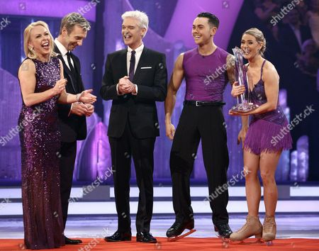 Ray Quinn and Maria Filippov are crowned as champions and are presented with the trophy by Phillip Schofield, Jayne Torvill and Christopher Dean