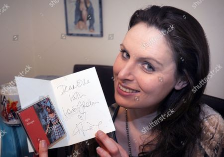 Stock Image of Elle Richardson with a rare Locomotion 3'' CD from Hong Kong worth around £300 and a birthday card from Kylie