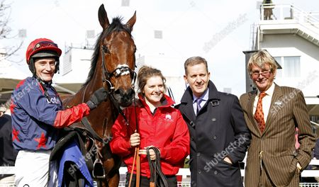 DORMELLO MIO (Daryl Jacob) with owners Jeremy Kyle and ANDY STEWART (brown suit) after The William Hill Juvenile Handicap Hurdle Sandown