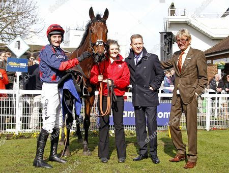 Stock Image of DORMELLO MIO (Daryl Jacob) with owners Jeremy Kyle and ANDY STEWART (brown suit) after The William Hill Juvenile Handicap Hurdle Sandown
