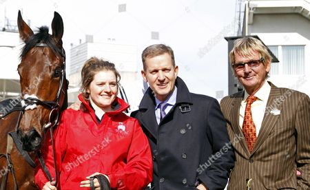 Stock Picture of DORMELLO MIO with owners Jeremy Kyle and ANDY STEWART (brown suit) after The William Hill Juvenile Handicap Hurdle Sandown