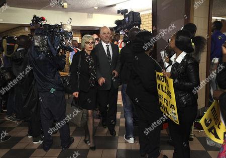 Arnold Pistorius and Lois Pistorius leaving the Pretoria High Court
