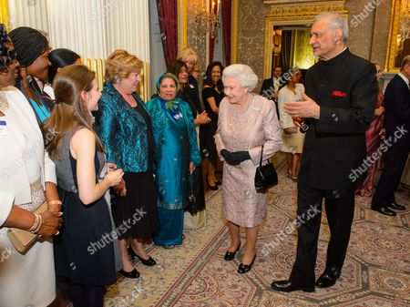 Queen Elizabeth II and Commonwealth Secretary General Kamalesh Sharma greet guests