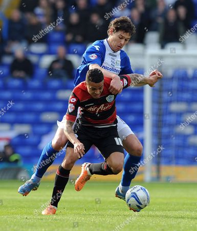 Nikola Zigic of Birmingham City and Jermaine Jenas of QPR