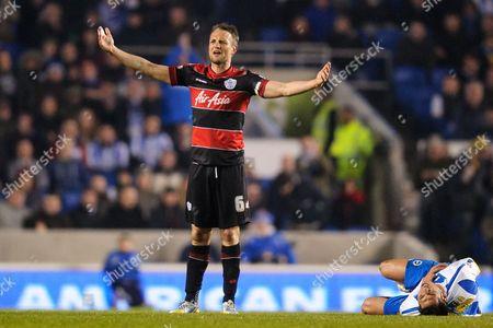 Clint Hill of QPR reacts after fouling Leonardo Araujo Ulloa of Brighton & Hove Albion