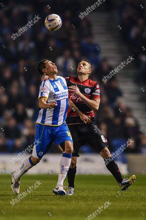 Clint Hill of QPR and Leonardo Araujo Ulloa of Brighton & Hove Albion