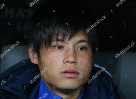 Ryo Miyaichi of Arsenal sits on the bench as his side warm up, as he is not registered in the clubs Champions League squad