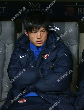 Ryo Miyaichi of Arsenal sits on the bench as his side warm up. Miyaichi was due to be named as a substitute but he cannot as he is not registered in the clubs Champions League squad, meaning Arsenal play with six substitutes