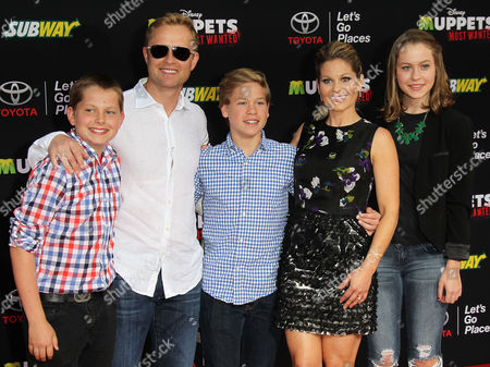 Valeri Bure and Candace Cameron Bure with daughter Natasha and sons Lev and Maksim