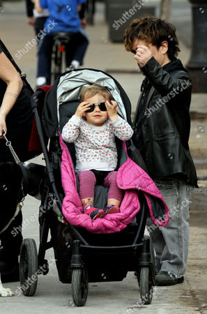 Peter Dinklage walks in the West Village with his daughter Zelig Dinklage
