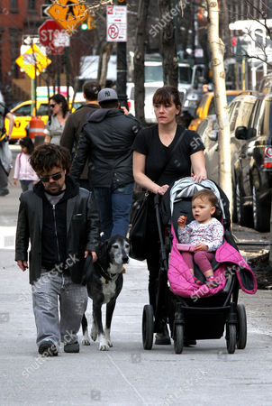 Peter Dinklage walks in the West Village with his daughter Zelig Dinklage and his wife Erica Schmidt