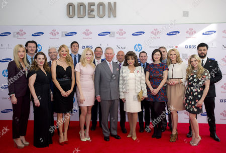 Celebrity guests Sam Bailey, Tess Daly, Vernon Kay, Pixie Lott, Adam West, Sir Ben Kingsley, Jeremy Irons, Jools Holland, Gabby Logan pose with Prince Charles