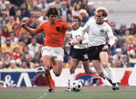 Football - 1974 World Cup Final - West Germany 2 Holland 1 West Germany's Uli Hoeness and Holland's Willem van Hanegem at the Olympiastadion, Munich. 07/07/1974
