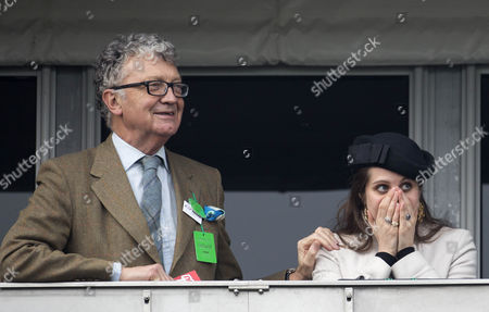 A tense moment for Annabel Waley Cohen as she cheers jockey husband Sam Waley-Cohen on during the Ryanair Chase which he came 3rd riding Rajdhani Express.