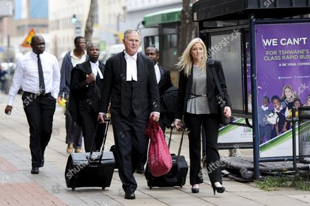 Stock Picture of Advocates Barry Roux and Roxanne Adams arrive at the Pretoria High Court