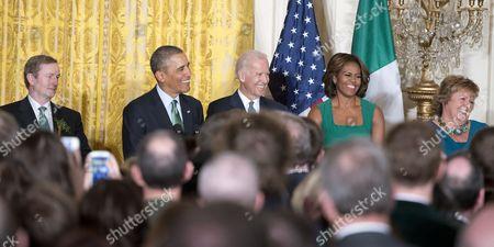 Prime Minister Enda Kenny of Ireland, Barack Obama, U.S. Vice President Joe Biden, first lady Michelle Obama, and Fionnuala O'Kelly, wife of Prime Minister Kenny