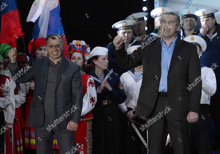 Prime Minister Sergey Aksyonov and Parliament Speaker Volodymyr Konstantynov celebrate the vote to join the Russian Federation