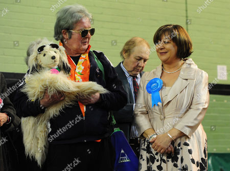 Editorial photo of Pictured: Losing Conservative Candidate Maria Hutchings (right) Stands With Other Losing Candidate 'elvis Loves Pets' (left) At The Count The Flemming Centre Eastleigh. Where The Votes Are Being Counted For The Result Of The Eastleigh By-election.