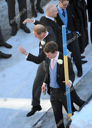 Arosa Switzerland. Wedding Of Laura Bechtolsheimer And Mark Tomlinson In Arosa Attended By William Harry And Kate. William Jokingly Slides Down An Icy Slope From The Church And Has A Laugh With Other Guests.  .