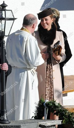 Arosa Switzerland. Wedding Of Laura Bechtolsheimer And Mark Tomlinson In Arosa Attended By William Harry And Kate. Kate Talks To The Priest Christopher Mulholland After The Church Service.  .