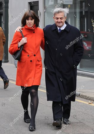 London. A Smiling Chris Huhne And His Partner Carina Trimingham Leave Their Flat In Old Street On The Way To Southwark Crown Court Where Mr Huhne Is Being Sentenced This Afternoon.  .