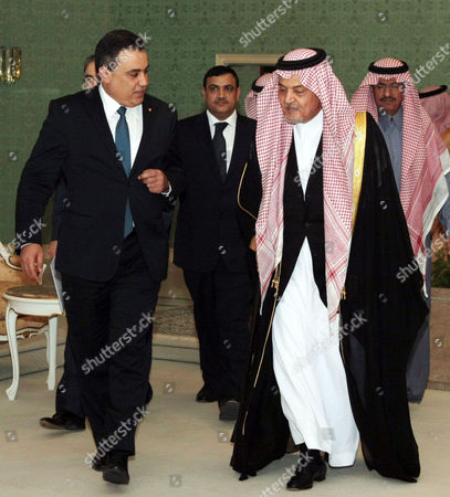 Saudian Foreign Minister Prince Saud al-Faisal and Tunisian Prime Minister Mehdi Jomaa at the Riadh Conference Palace in Saudi Arabia