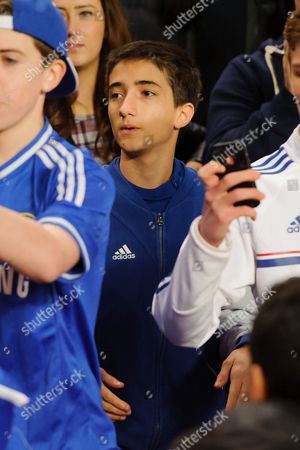 Jose Mario the son of Chelsea Manager Jose Mourinho watches from the crowds
