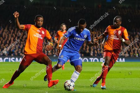 Stock Picture of Samuel Eto'o of Chelsea takes on Aurelien Chedjou and Emmanuel Eboue of Galatasaray