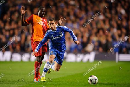 Stock Image of Eden Hazard of Chelsea runs past Emmanuel Eboue of Galatasaray
