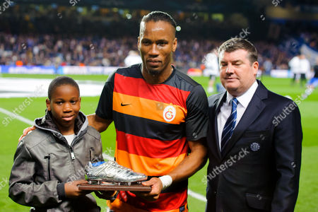 Didier Drogba of Galatasaray is awarded a silver boot by Chelsea by Chief Executive Ron Gourlay